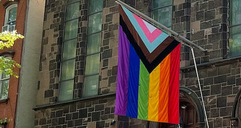 Photograph of Pride/Rainbow flag on church building